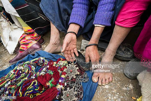 Berber women display antique wedding jewelry for sale at the Imilchil Morocco Marriage and Betrothal Festival