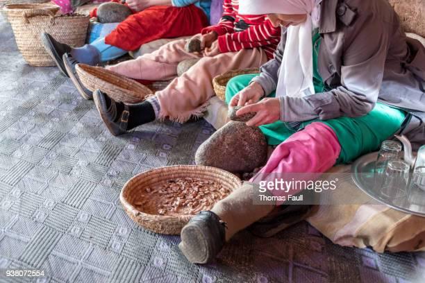 Berber women making Argon Oil in co-operative in Morocco