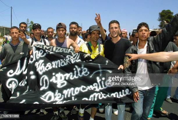 Berber youths who walked from their village of OuedAmizour in Kabylia march 13 June 2001 in the vicinity of Naciria 70 kms east of the capital...