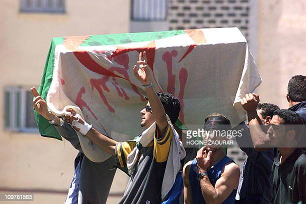 Berbers carrying a coffin symbolizing the police forces which protesters want out of the city 28 May 2001 during a march by some 20000 people in...