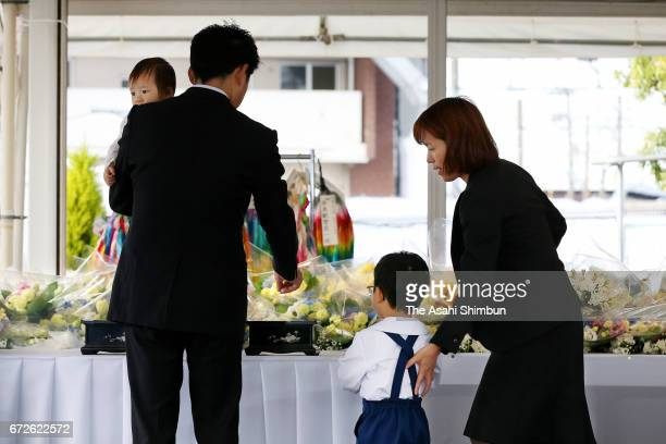 Bereaved family members offer payers at an altar during the memorial ceremony on the twelveth anniversary of the train derailment accident on April...