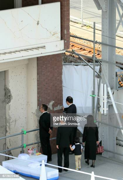 Bereaved family members visit the wall of the apartment building on the twelveth anniversary of the train derailment accident on April 25 2017 in...
