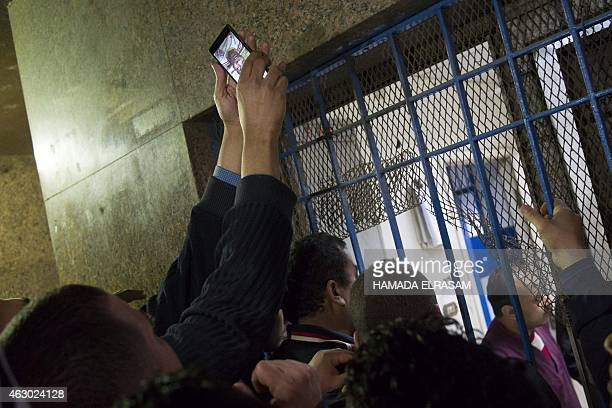 Bereaved friends and family check for names at the Zynhom morgue in Cairo on February 8 2015 At least 22 people were killed in clashes between...