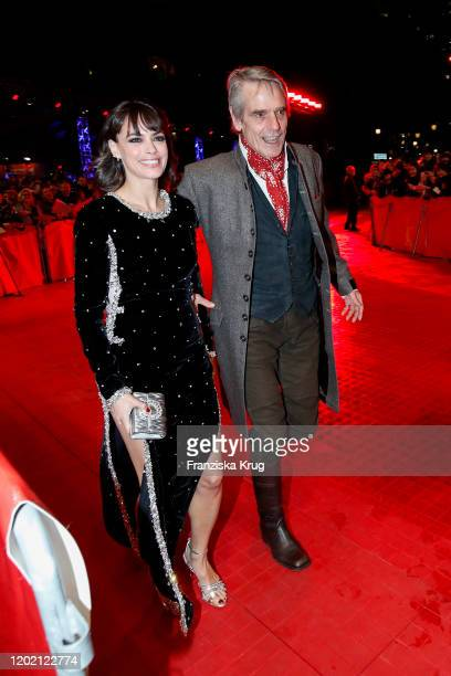 Berenice Bejo and Jeremy Irons arrives in Audi etron car for opening ceremony and My Salinger Year premiere during the 70th Berlinale International...