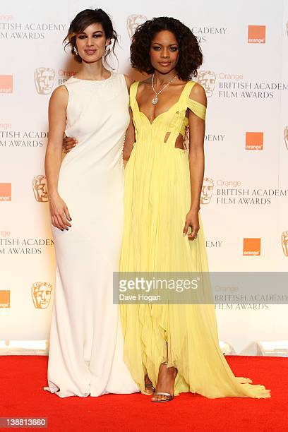 Berenice Marlohe and Naomie Harris pose in the press room at The Orange British Academy Film Awards 2012 at The Royal Opera House on February 12 2012...