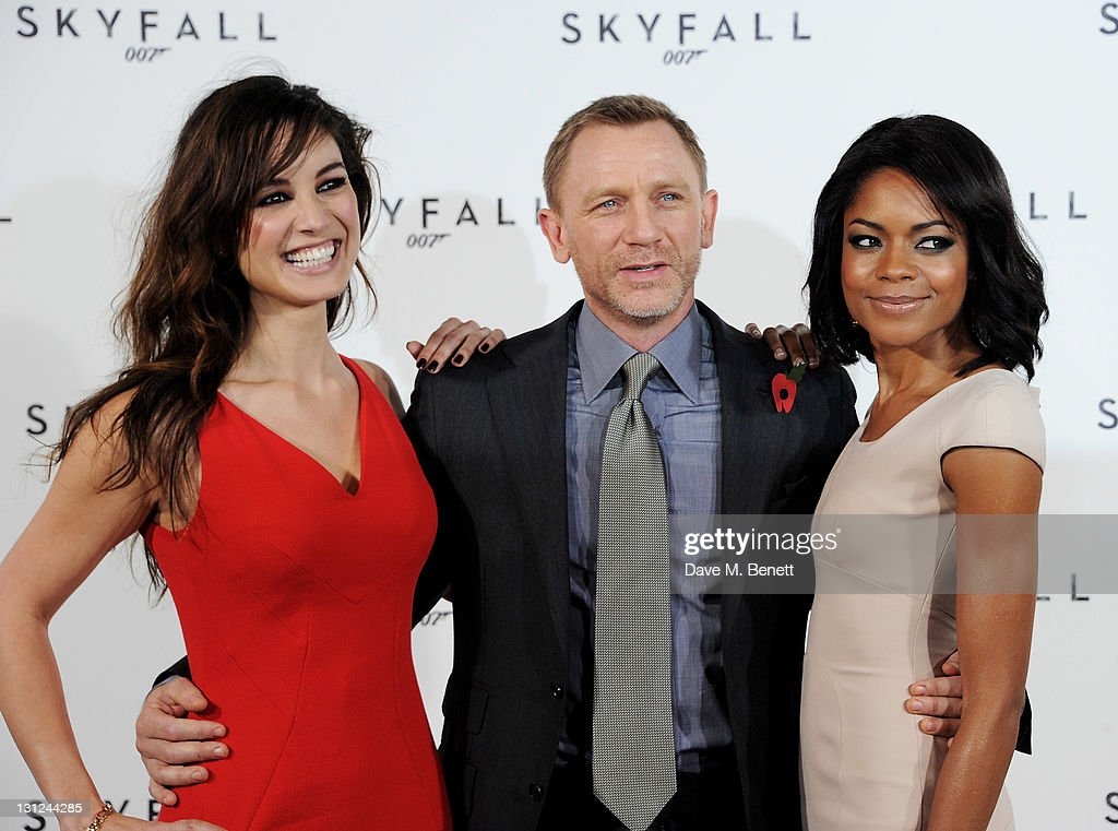 Berenice Marlohe, Daniel Craig and Naomie Harris attend a photocall with cast and filmmakers to mark the start of production which is due to commence on the 23rd Bond Film and announce the title of the film as 'Skyfall' at Massimo Restaurant & Oyster Bar on November 3, 2011 in London, United Kingdom.