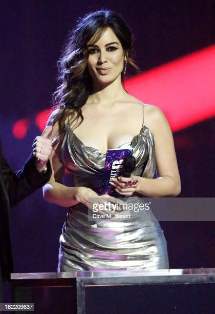 Berenice Marlohe presents on stage at the Brit Awards at 02 Arena on February 20 2013 in London England