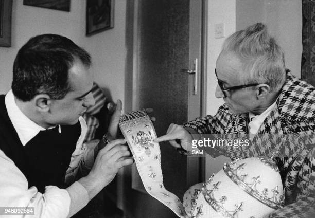 Bergamo April 1959 The sculptor Attilio Nani with her sons workin on the tiara that the provincial government will offer to Pope John XXIII May 2,...