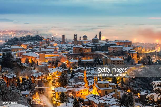 bergamo at sunset in italy. - bergamo stock pictures, royalty-free photos & images