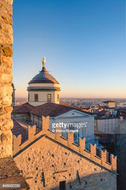 Bergamo Cathedral and the cityscape of Città Alta (upper town) at sunset. Bergamo, Italy.