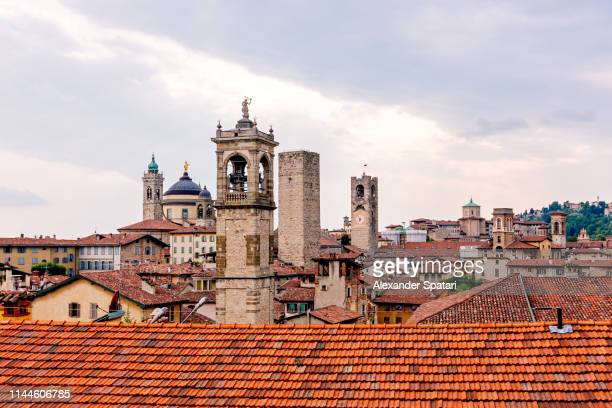 bergamo old town skyline at sunset, lombardy, italy - bergamo stock pictures, royalty-free photos & images
