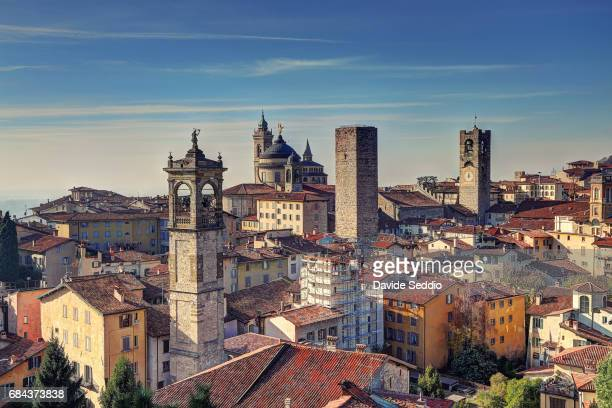 bergamo towers viewed from the rocca - bergamo stock pictures, royalty-free photos & images