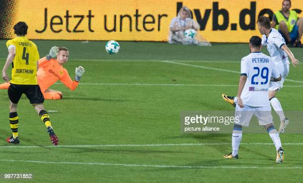 Bergamo's Josip Ilicic defeats Dortmund goalkeeper Dominik Reimann and scores the opener while Dortmund's Neven Subotic arrives to late during the...