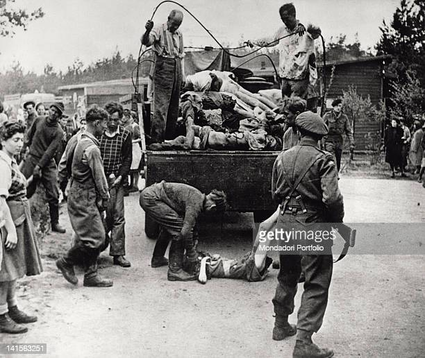 Bergen Belsen camp on the Second British Army arrival The dead bodies of the inmates are loaded on a lorry Germany 1945
