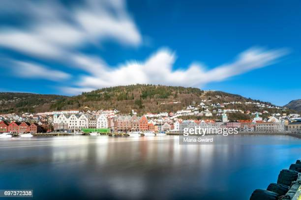 bergen -  city panorama in spring with moving clouds - bergen norway stock pictures, royalty-free photos & images