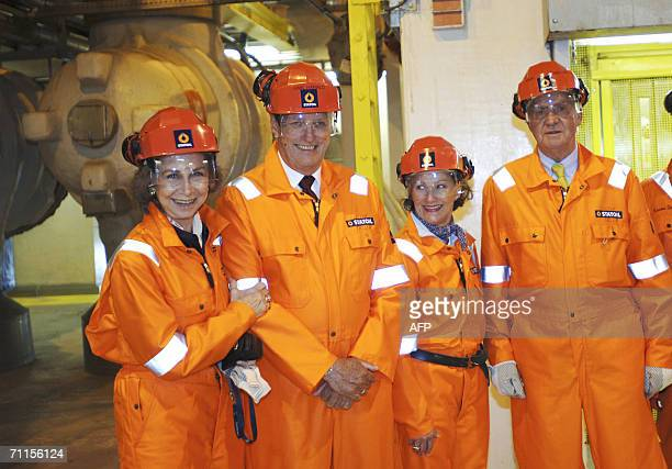 Queen Sofia of Spain King Harald Queen Sonja of Norway and King Juan Carlos of Spain pose 08 June 2006 onboard oil rig Troll A in the North Sea on...