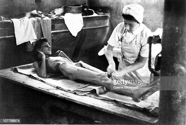 BergenBelsen Concentration Camp Treatment of a survivor after the camp has been taken over by the Allied 21st Army Group 15th April 1945 55000...