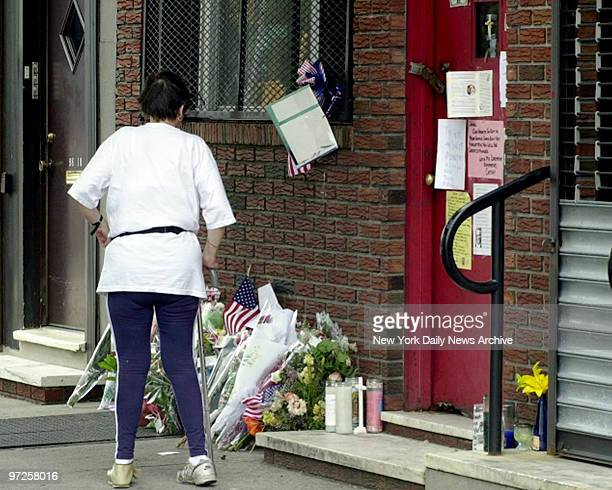Bergin Hunt and Fish Social Club Flowers line the sidewalk and notes and the front page of the Daily News along with money are taped to the front...