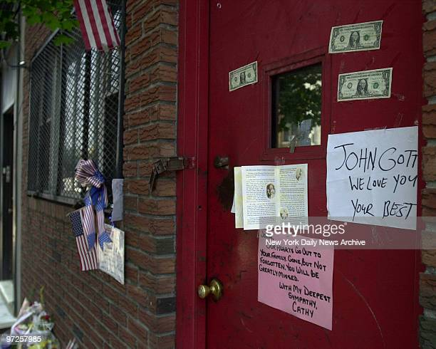 Bergin Hunt and Fish Social Club on 101 Avenue and 99th Street in Ozone Park Queens Flowers for John Gotti line the sidewalk with notes and the front...