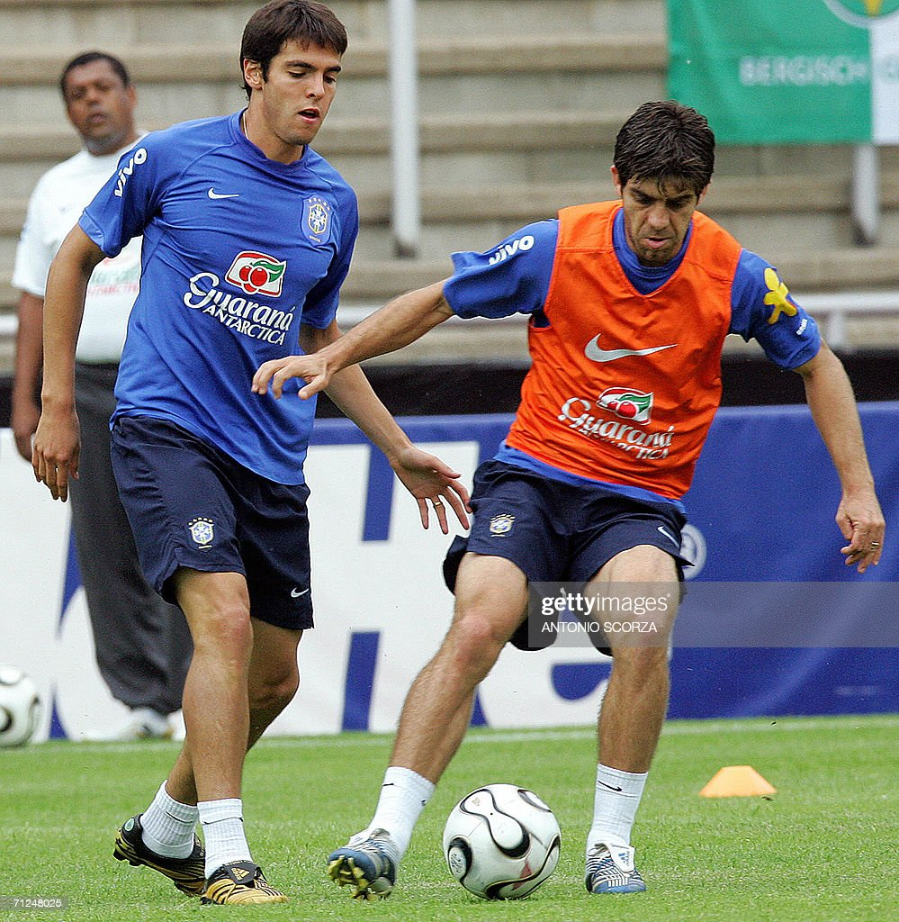 Brazilian players Kaka (L) and Juninho fight for the ball during a training session at Bergisch Gladbach stadium, 20 June 2006. Despite having already reached the last 16, Brazil intend to show no mercy to winless Japan on June 22 even though they are coached by Zico, one of the South American country's favourite sons.