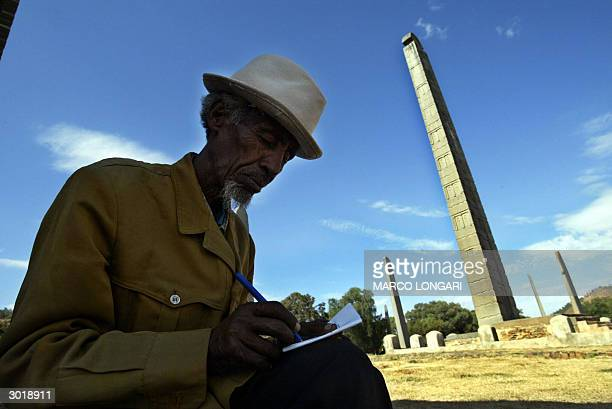 Berhane Gebrewahid the guardian for thirty years of the Aksumite Steleas takes note 25 February 2004 on the historical site where the nearly 2300...