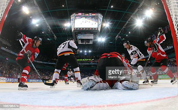 Berhard Starkbaum goaltender of Austria makes a save on Andre Rankel of Germany during the IIHF World Championship group H match between Austria and...