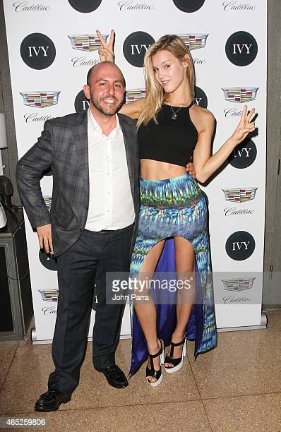 Beri Meric and Model Joy Corrigan attend the Miami Innovator Dinner Presented By Cadillac And IVY at The Betsy Hotel on March 4 2015 in Miami Florida