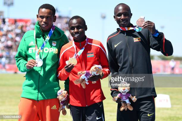 Berihu Aregawi of Ethipia Jackson Kavesa Muema of Kenia and Oscar Chelimo of Uganda look on in the victory ceremony of Men's Cross Country during day...