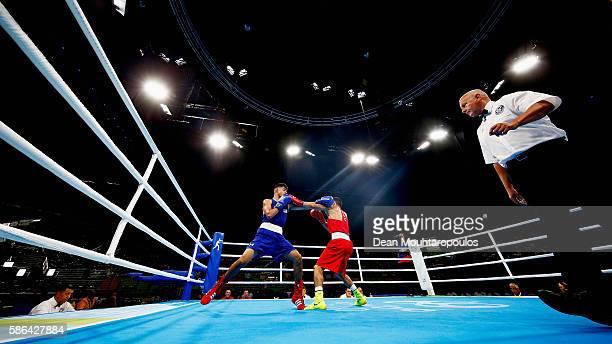 Berik Abdrakhmanov of Kazakhstan and Carlos Zenon Balderas Jr of The United States of America Team US compete in their Men's light weight 60 kg...