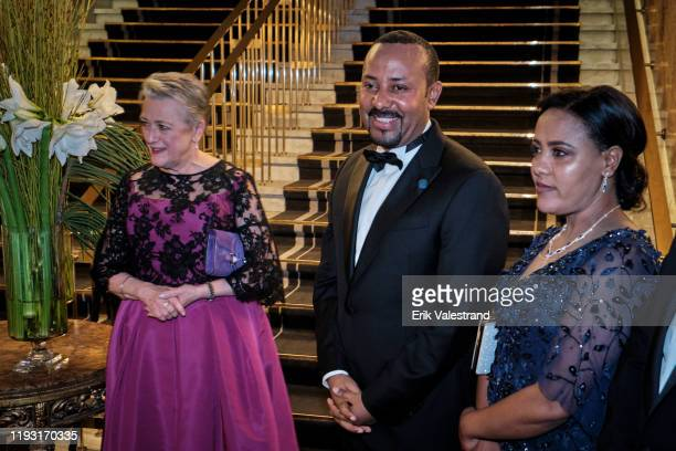 Berit Reiss-Andersen, Abiy Ahmed and Zinash Tayachew arrive at the Nobel Peace prize banquet dinner honoring the Nobel Laureates at Grand Hotel on...