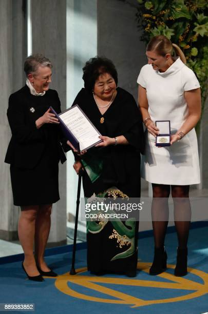 Berit ReissAndersen chairperson of the Norwegian Nobel Committee hands over the 2017 Nobel Peace Prize to Beatrice Fihn leader of ICAN and Hiroshima...