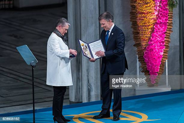 Berit Reiss-Andersen of Norway, President Juan Manuel Santos of Colombia receives his Nobel Peace Prize Award during the Nobel Peace Prize ceremony...