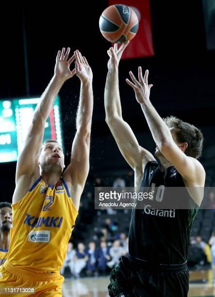 Berk Demir of Darussafaka Tekfen in action against Sergei Monja of Khimki during Turkish Airlines Euroleague week 27 basketball match between...