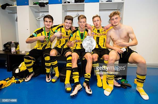 Berkant Guener Jan Philipp Binias Felix Passlack Dzenis Burnic Jacob Bruun Larsen fl of Dortmund celebrate in the dressing room with the trophy after...