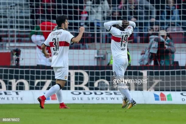 Berkay Oezcan of Stuttgart and Chadrac Akolo of Stuttgart gesture during the Bundesliga match between VfB Stuttgart and FC Bayern Muenchen at...
