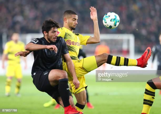 Berkay Oezcan of Stuttgart and Jeremy Toljan of Dortmund battle for the ball during the Bundesliga match between VfB Stuttgart and Borussia Dortmund...