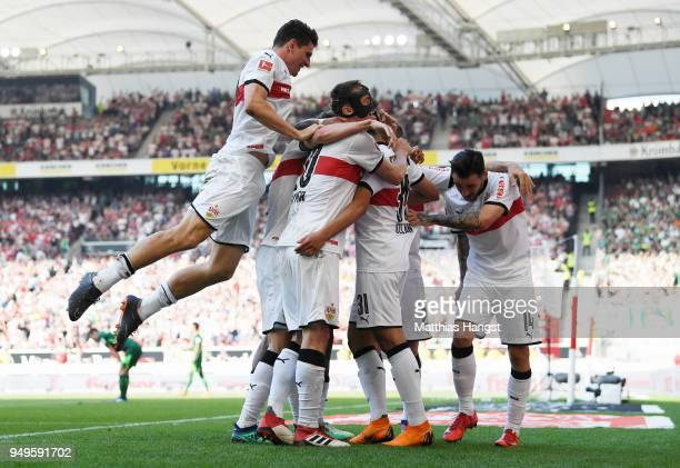 Berkay Oezcan of Stuttgart celebrates with his teammates after scoring his team's second goal during the Bundesliga match between VfB Stuttgart and...