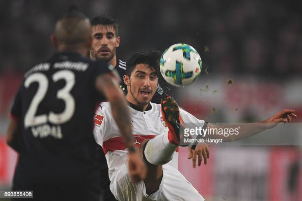 Berkay Oezcan of Stuttgart fights for the ball with Javi Martinez of Bayern Muenchen as Arturo Vidal of Bayern Muenchen watches during the Bundesliga...