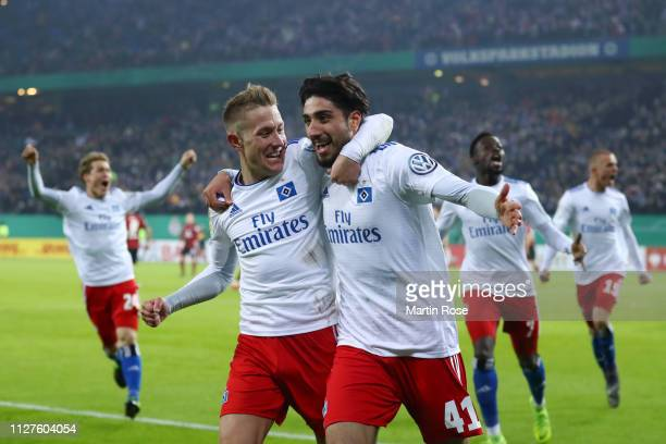 Berkay Ozcan of Hamburg celebrates with Lewis Holtby of Hamburg after he scores his sides first goal during the DFB Cup match between Hamburger SV...