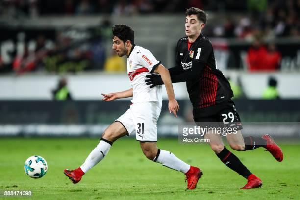 Berkay Ozcan of VfB Stuttgart and Kai Havertz of Bayer Leverkusen battle for the ball during the Bundesliga match between VfB Stuttgart and Bayer 04...