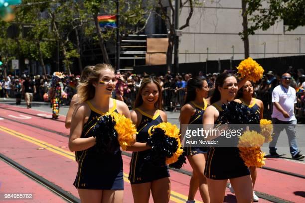 Berkeley cheerleaders walk during the 2018 San Francisco Pride Parade on June 24 2018 in San Francisco California