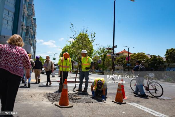 berkeley construction workers - gado stock photos and pictures