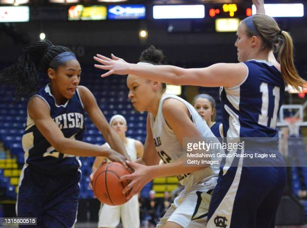 Berks Catholic's Devon Merritt struggles for the ball with Conrad Weiser's TaCari Talford and Conrad Weiser's Gwyn Price . Girls Basketball, the...