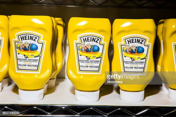 Berkshire Hathaway branded bottled of Kraft Heinz Co Yellow Mustard are displayed during a shareholders shopping day ahead of the Berkshire Hathaway...