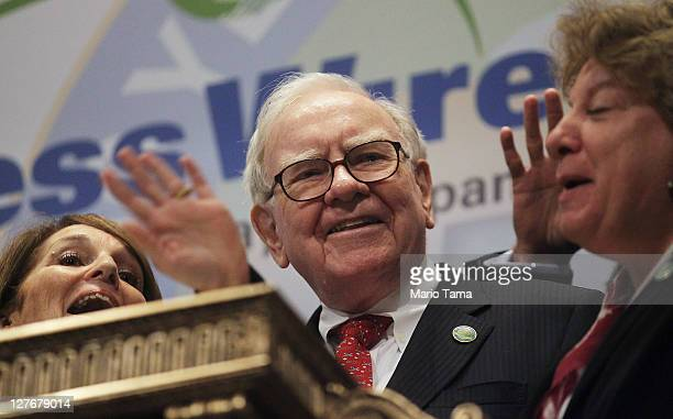 Berkshire Hathaway Chairman and CEO Warren Buffett smiles at the New York Stock Exchange before ringing the opening bell on September 30 2011 in New...