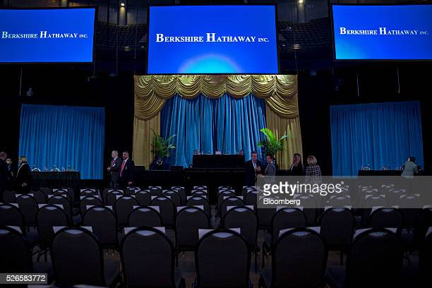 Berkshire Hathaway Inc signage appears on screens above the stage ahead of the company's annual shareholders meeting in Omaha Nebraska US on Saturday...