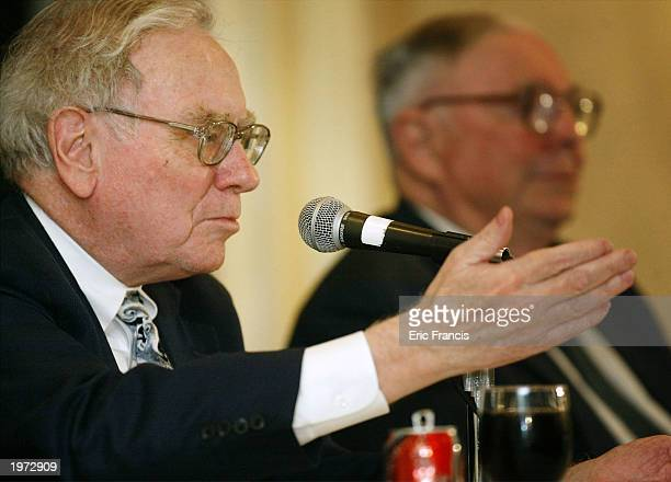 Berkshire Hathaway's CEO Warren Buffett and his business partner Vice Chairman Charles Munger answer questions at a news conference May 4, 2003 in...