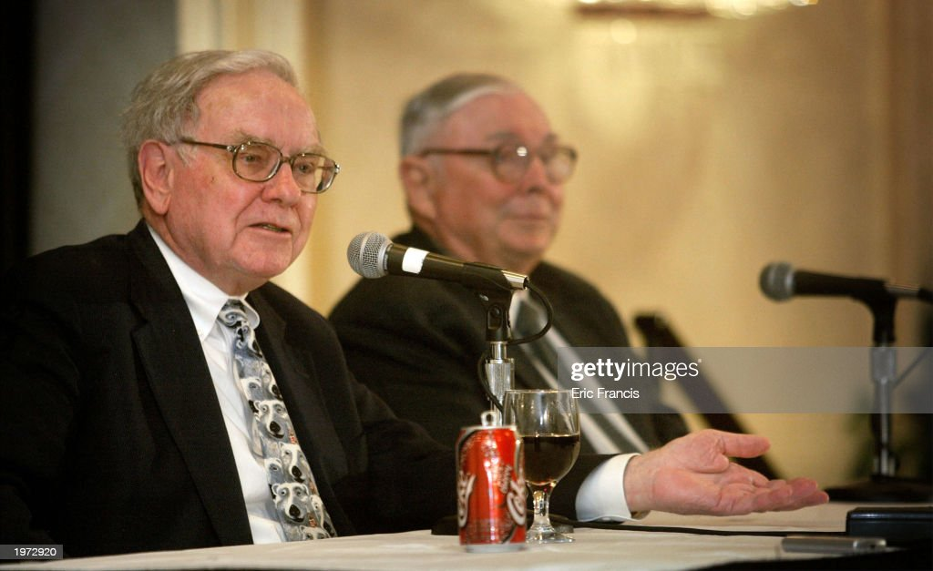 Berkshire Hathaway's CEO Warren Buffett (L) and his business partner Vice Chairman Charles Munger answer questions at a news conference May 4, 2003 in Omaha, Nebraska. Buffett attended the Berkshire Hathaway 2003 annual shareholders' meeting May 3, where he spoke about excessive executive salaries, the company's record first-quarter earnings of $1.7 billion, and announced that there are four possible candidates to succeed him when he leaves.