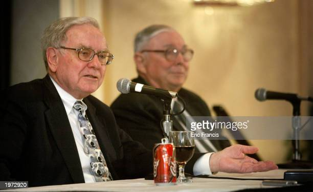 Berkshire Hathaway's CEO Warren Buffett and his business partner Vice Chairman Charles Munger answer questions at a news conference May 4 2003 in...