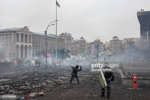 Berkut riot police throw stones at antigovernment protesters who are throwing rocks in return on Independence Square on February 19 2014 in Kiev...